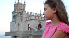 Woman and Castle Swallows Nest with tourists on rock near sea. Stock Footage