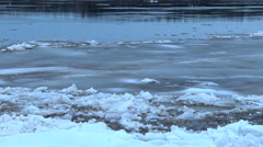 Large block of ice ripped from the shore of the river Stock Footage