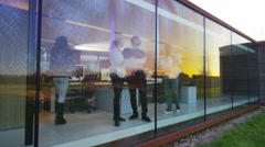 4K Designers or architects in meeting, seen through the glass of modern office Stock Footage