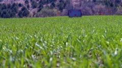 DOLLY MOTION: Retro tv on grass Stock Footage