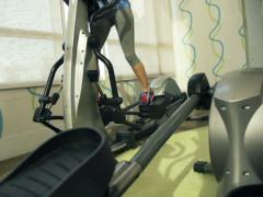 Woman exercising on elliptical machine in gym, super slow motion, 240fps NTSC Stock Footage