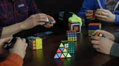 Group of People Solving Rubik's Cube Stock Footage