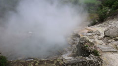 Hot spring with boiling water at the Caldeiras in the city of Furnas Stock Footage