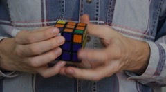 Solving Rubik's Cube puzzle Stock Footage