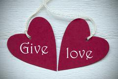Two Red Hearts With Give Love - stock photo