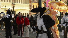 Dressed actors posing for tourists at dawn during the carnival of Venice Italy Stock Footage