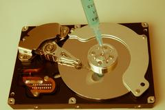 Hdd and a syringe Stock Photos