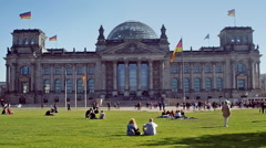 Tourists and locals enjoying the summer sun in front of the Bundestag in Berlin. Stock Footage