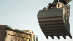 Dredge excavating ground, tracking shot to shovel loading dump track, close up. Stock Footage