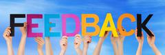 Hands Hold Colorful Straight Word Feedback Sky - stock photo