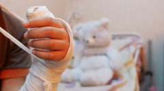 Child hand in plaster recovery Stock Footage