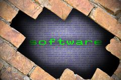Hole In Brick Wall With Software Word Inside - stock photo