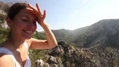 Beutiful girl enjoying panorama on hills - stock footage