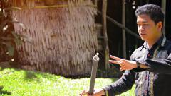 BORNEO, MALAYSIA - CIRCA JAN 2015: Professional tour guide explains the use o Stock Footage