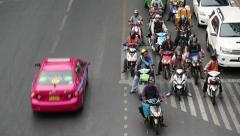 Road traffic in Bangkok, Thailand. Many people ride motorcycles Stock Footage