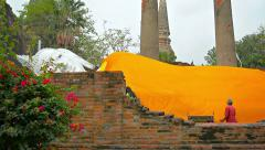 AYUTTHAYA, THAILAND - CIRCA FEB 2015: Workers covering an enormous Buddha scu - stock footage