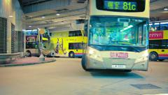 HONG KONG, CHINA - CIRCA JAN 2015: Double decker buses moving into staging po Stock Footage