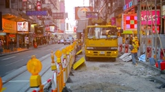 HONG KONG, CHINA - CIRCA JAN 2015: Crane equipped truck backing up under dire Stock Footage