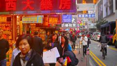 HONG KONG, CHINA - CIRCA JAN 2015: Brightly lit signs over a busy downtown si Stock Footage