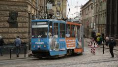 Blue tramway near the Dormition or Assumption church in Lviv, Western Ukraine Stock Footage