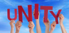Many People Hands Holding Red Word Unity Blue Sky - stock photo