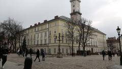 People on the Market Square near the Lviv Town Hall in Western Ukraine Stock Footage
