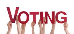 Many People Hands Holding Red Straight Word Voting - stock photo