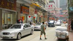 HONG KONG, CHINA - CIRCA JAN 2015: Shoppers and customers strolling amongst t Stock Footage
