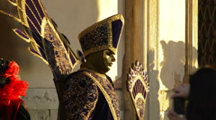 Venice carnival : mysterious golden mask posing at dawn Stock Footage