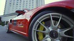 Detail tire brake system of red Porsche-slow motion Stock Footage