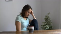 Worried woman drinking coffe 4k attractive young female girl Stock Footage