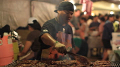 Grilling Meat on GUAM, USA- CIRCA February, 2011 Stock Footage