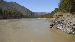Floods of muddy water on the mountain river Katun in Altai Stock Footage