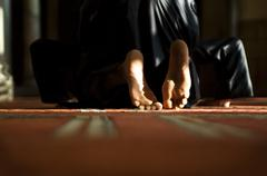 Religious inside the mosque of al azhar in Cairo - stock photo