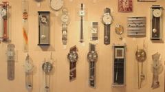 Antique wall clocks in a clock store, ticking the time - stock footage