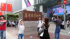 Crowded visitors and travelers walking at Shanghai Nanjing Road on April 30 Stock Footage