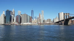 Manhattan and Brooklyn Bridge across East River in New York Stock Footage