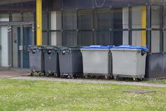 Row of large wheelie bins for rubbish, recycling and garden waste - stock photo