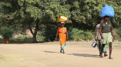 People carrying burdens on their heads. Stock Footage