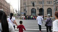 Crowded visitors and travelers walking at Shanghai Nanjing Road Stock Footage
