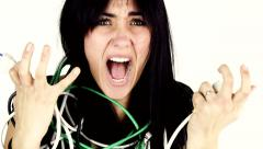 Closeup of screaming woman desperate about cables surrounding her Stock Footage