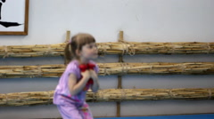 Little girl is engaged in gymnastics Stock Footage