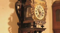 Old antique clock hanging on the wall in a clock store Stock Footage