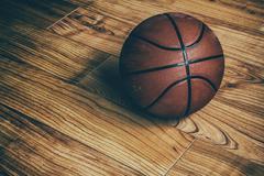 Basketball on Hardwood 1 - stock photo