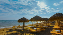Summer timelapse tropical beach umbrellas chairs Stock Footage