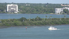 Boats Sail By Palm Tree Covered Causeway In Clearwater Floirda - stock footage