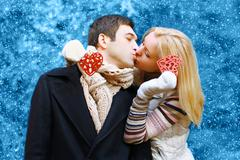 Christmas, valentines day, winter and people concept - happy pretty young cou - stock photo