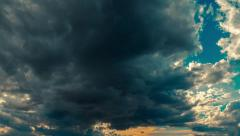 Sky sunset time lapse storm clouds disperse sun emerges Stock Footage