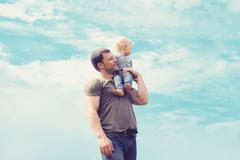 Lifestyle atmospheric portrait happy father and son having fun outdoors again Stock Photos