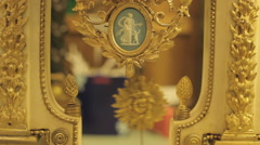Pendulum of an antique French clock is ticking the time, close up - stock footage